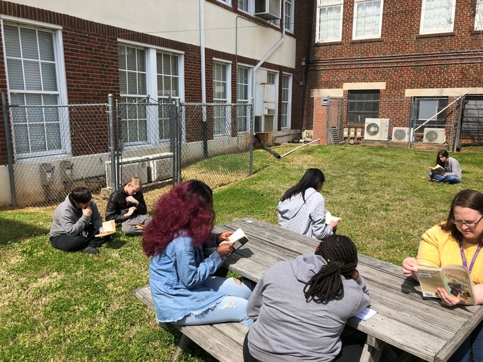 English class reading outside